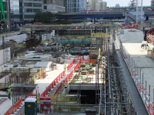 Photo of Canary Wharf Crossrail Station under construction by Expanded Group from bridge looking west