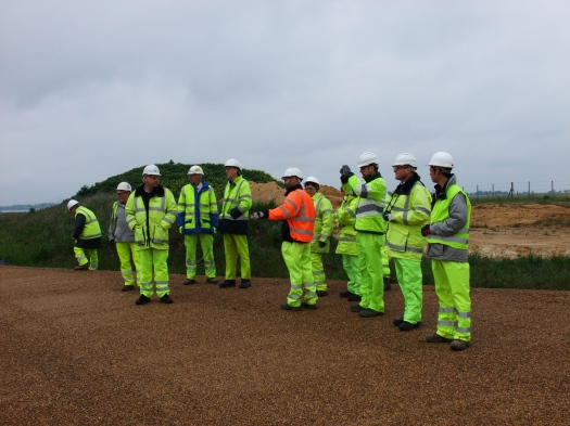 The group viewing the works to the B1026 Causeway